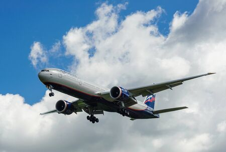 airstrip: SHEREMETYEVO, MOSCOW REGION, RUSSIA - June 28, 2017: Boeing 777-300ER of Aeroflot Airlines makes a landing at Sheremetyevo International Airport.