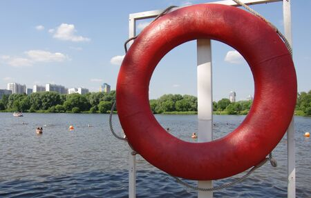drown: Red lifebuoy on the shore of the lake