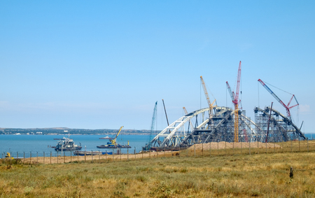 KERCH, RUSSIA, JULY 15, 2017: construction of a bridge with road and rail passages across the Kerch Strait, which will connect the Taman Peninsula and the Crimea. Stock Photo