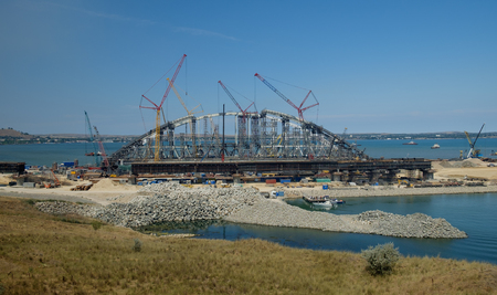 KERCH, RUSSIA, JULY 15, 2017: construction of a bridge with road and rail passages across the Kerch Strait, which will connect the Taman Peninsula and the Crimea. Editorial