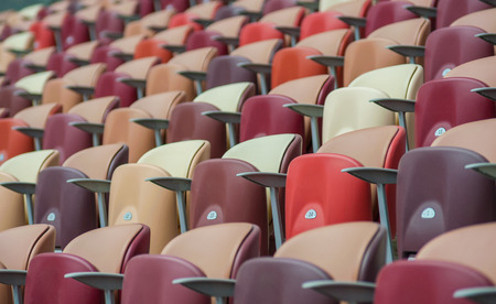 Multi-colored armchairs in a sports stadium Stock Photo