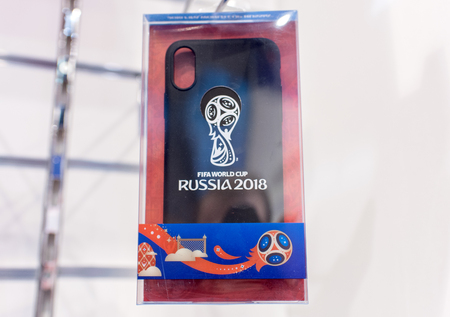 14 December 2017 Moscow, Russia, Symbols of the 2018 FIFA World Cup on mobile phone cases in the official store. Editorial