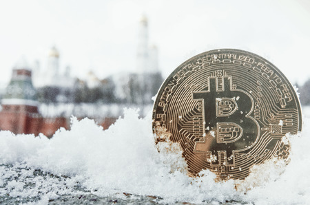 Gold coin bitcoin on the background of the Moscow Kremlin. Toned.