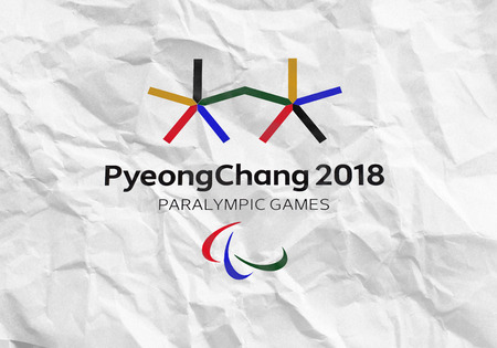 14 December 2017 Moscow, Russia Symbols XII Winter Paralympic Games in Pyeongchang, Republic of Korea on a sheet of crumpled paper