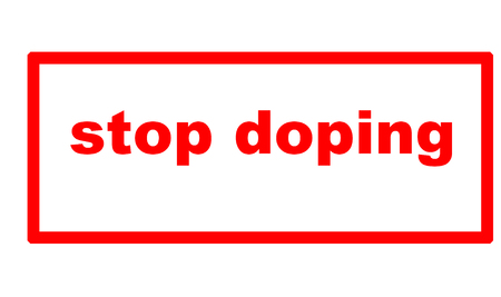 Caption Stop Doping on a sheet of white paper Stock Photo