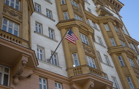 The US national flag on the building of the Embassy of the United States of America in Moscow. Editorial