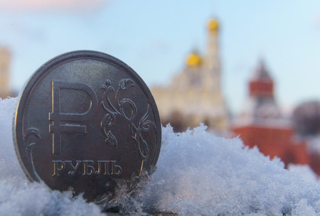 A coin worth one Russian ruble against the backdrop of the Moscow Kremlin.