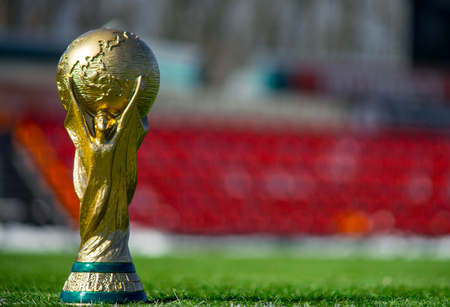 April 9, 2018 Moscow, Russia Trophy of the FIFA World Cup on the green grass of the football field.
