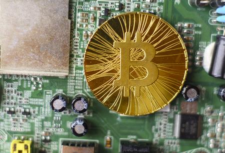 gold souvenir coin bitcoin on a computer circuit board background stock photo 101726833