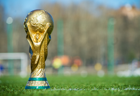 April 9, 2018 Moscow, Russia Trophy of the FIFA World Cup on the green grass of the football field. Редакционное