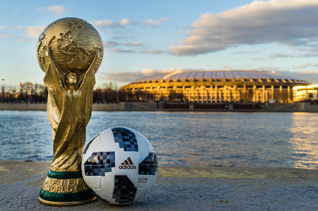 April 13, 2018 Moscow, Russia Trophy of the FIFA World Cup and official ball of FIFA World Cup 2018 Adidas Telstar 18  against the backdrop of the Luzhniki stadium in Moscow. Editoriali