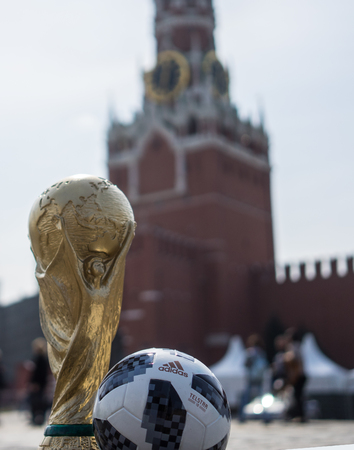 April 16, 2018 Moscow. Russia Trophy of the FIFA World Cup and official ball of FIFA World Cup 2018 Adidas Telstar 18 on the Red Square in Moscow. Editorial