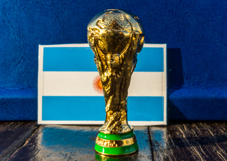June 6, 2018 Moscow, Russia. FIFA World Cup trophy on the background of the flag of Argentina.