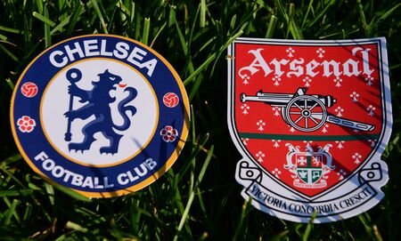 September 6, 2019 London, UK. Emblems of English football clubs rsenal F.C. London  and Chelsea London on the green lawn grass.