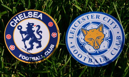 September 6, 2019 London, UK. Emblems of English football clubs Chelsea London and Leicester City on the green lawn grass.