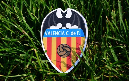 September 6, 2019 Istanbul, Turkey. The emblem of the Spanish football club Valencia on the green grass of the football field.