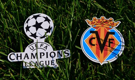 September 6, 2019 Istanbul, Turkey. The emblem of the Spanish football club Villarreal next to the logo of the Champions League on the green grass of the football field.