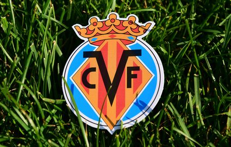 September 6, 2019 Istanbul, Turkey. The emblem of the Spanish football club Villarreal on the green grass of the football field.