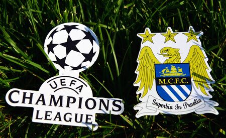September 6, 2019 Istanbul, Turkey. The emblem of the English football club Manchester City next to the logo of the Champions League on the green grass of the football field. Redactioneel