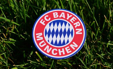 September 6, 2019 Istanbul, Turkey. The emblem of the German football club Bayern Munich on the green grass of the football field.