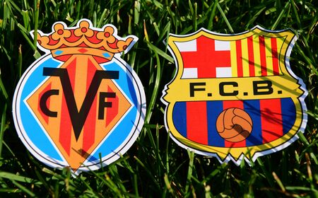 September 6, 2019, Madrid, Spain. Emblems of Spanish football clubs Barcelona and Villarreal on the green grass of the lawn.
