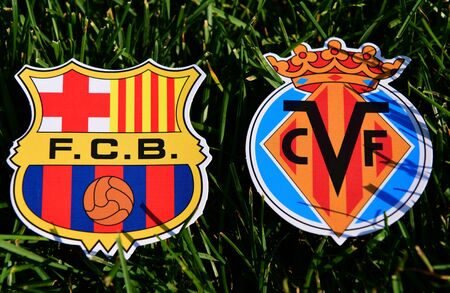 September 6, 2019, Madrid, Spain. Emblems of Spanish football clubs Barcelona and Villarreal on the green grass of the lawn. Editorial