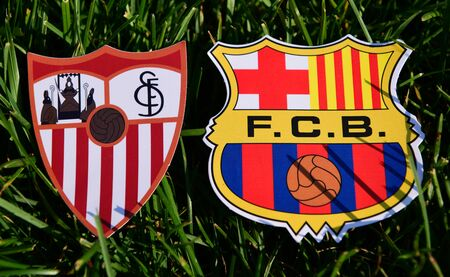 September 6, 2019, Madrid, Spain. Emblems of Spanish football clubs Barcelona and Sevilla on the green grass of the lawn.