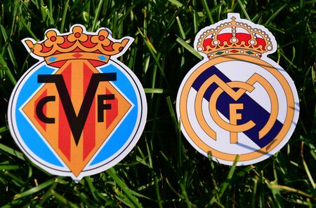 September 6, 2019, Madrid, Spain. Emblems of Spanish football clubs Real Madrid and Villarreal on the green grass of the lawn.