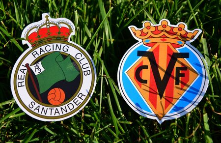 September 6, 2019, Madrid, Spain. Emblems of Spanish football clubs Real Racing de Santander and Villarreal on the green grass of the lawn. Editorial