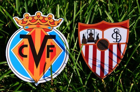 September 6, 2019, Madrid, Spain. Emblems of Spanish football clubs Villarreal and Sevilla on the green grass of the lawn.