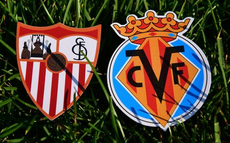 September 6, 2019, Madrid, Spain. Emblems of Spanish football clubs Villarreal and Sevilla on the green grass of the lawn. Editorial