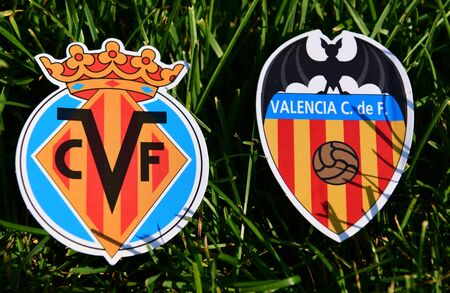September 6, 2019, Madrid, Spain. Emblems of Spanish football clubs Villarreal and Valencia on the green grass of the lawn.