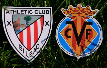 September 6, 2019, Madrid, Spain. Emblems of Spanish football clubs Villarreal and Athletic Bilbao on the green grass of the lawn.