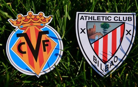 September 6, 2019, Madrid, Spain. Emblems of Spanish football clubs Villarreal and Athletic Bilbao on the green grass of the lawn. Editorial