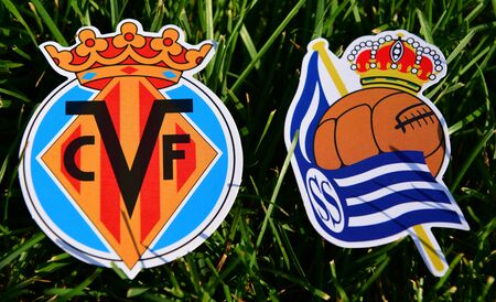 September 6, 2019, Madrid, Spain. Emblems of Spanish football clubs Villarreal and Real Sociedad San Sebastian on the green grass of the lawn.