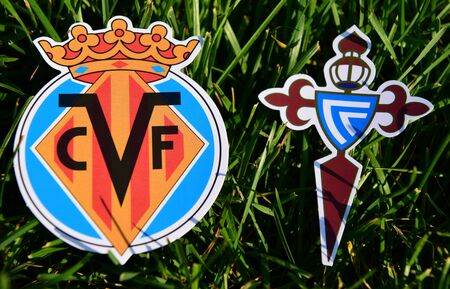 September 6, 2019, Madrid, Spain. Emblems of Spanish football clubs Villarreal and Celta Vigo on the green grass of the lawn.