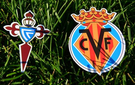 September 6, 2019, Madrid, Spain. Emblems of Spanish football clubs Villarreal and Celta Vigo on the green grass of the lawn. Editorial