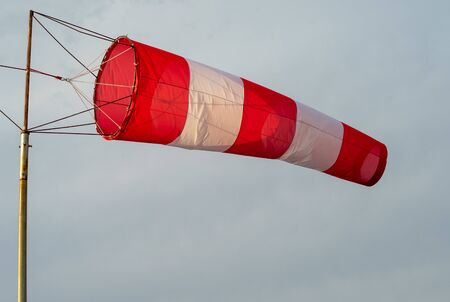 red-and-white wind designator designed to indicate the direction and approximate speed of the wind on the seashore