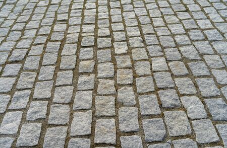 Old cobblestone pavement in the ancient European city Stockfoto