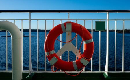 Lifebuoy on the railing of one of the decks of a tourist ferry Stockfoto