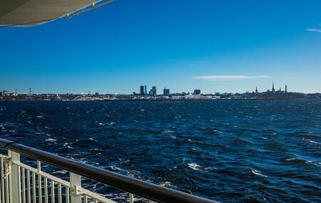April 21, 2018. Tallinn, Estonia. View of the historic center of Tallinn from the side of a passenger ferry in clear weather.