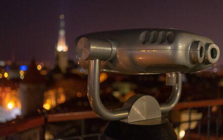 tourist binoscope on the observation deck in Tallinn at night