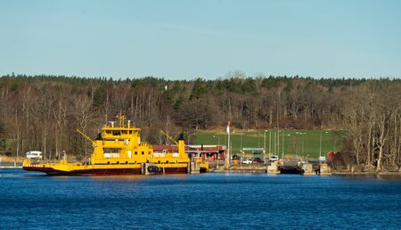 Yellow ferry for transporting cars and people from the islands of the Stockholm archipelago to the mainland