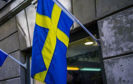 Sweden flag on a street in Stockholm.