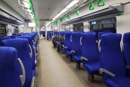 Blue seats in a high-speed train car.