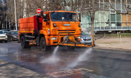 March 28, 2020, Moscow, Russia. Municipal equipment performs sanitary treatment of the street. 新闻类图片