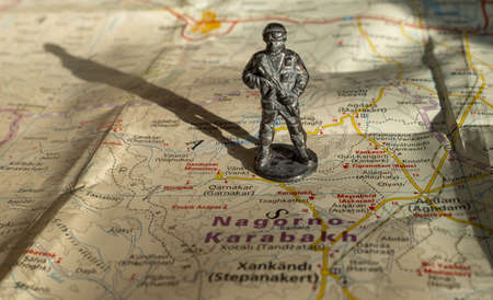 A figurine of an armed soldier on the map of Nagorno-Karabakh.