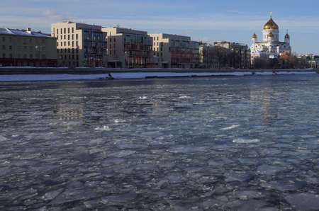 Spring ice drift on the Moscow river on a clear Sunny day. Cathedral Of Christ The Savior.