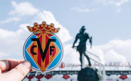 June 14, 2021 Villarreal, Spain. The emblem of the football club Villarreal CF against the background of a modern stadium.