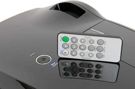 home theater: Proiettore nero home theater con telecomando carta di credito